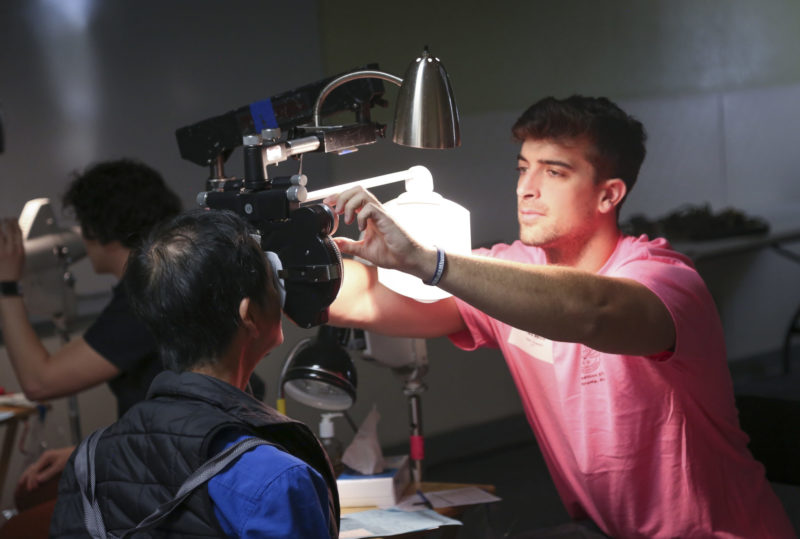 Ophthalmic Tech Michael Cable conducts an exam at the RAM clinic in Pahrump.