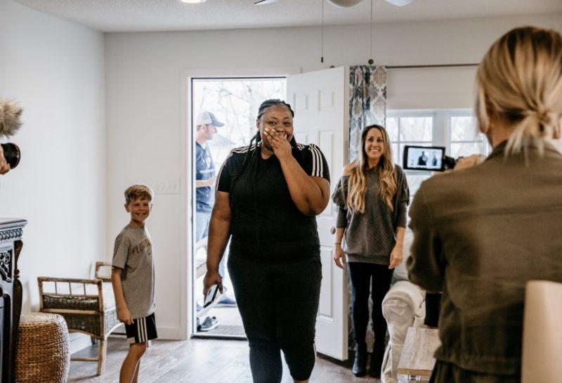Lisa Odom is overwhelmed as she sees the inside of her rebuilt home
