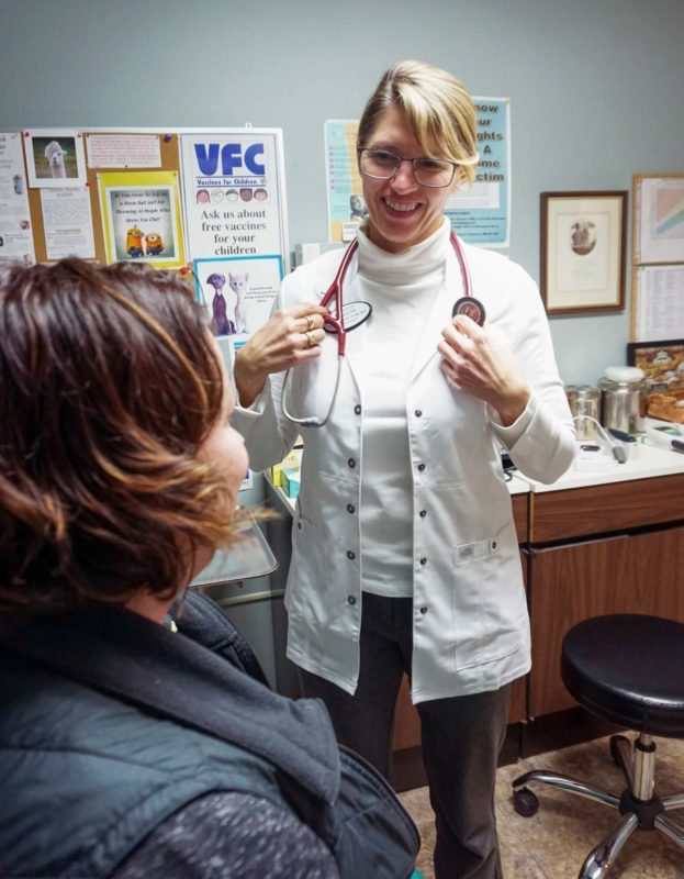 Physician's Assistant Christina Rust treats a patient at the Sherman County Medical Clinic