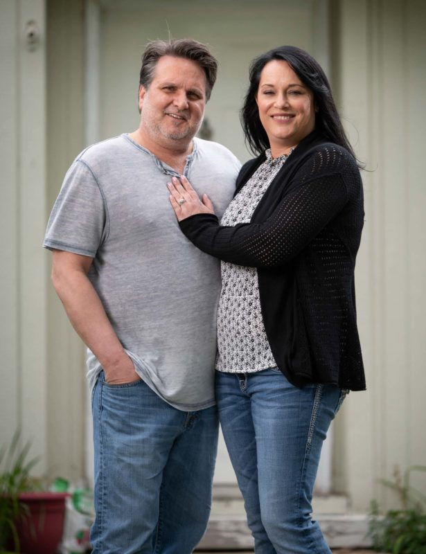 Michelle and her husband, Brent, outside their home in La Grande.